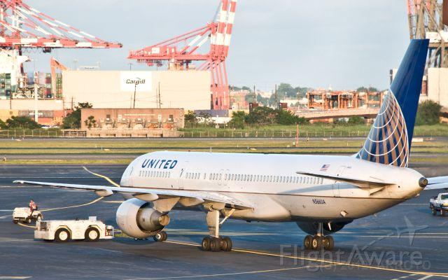 Boeing 757-200 (N566UA) - UAL 752 pushing back at EWR in June 2012