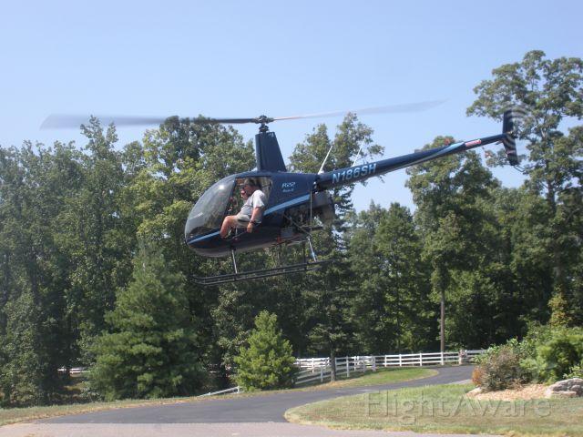Robinson R-22 (N186SH) - Paul Salmon, CFII and Tim Brumitt- student 2010 , departing Tims driveway