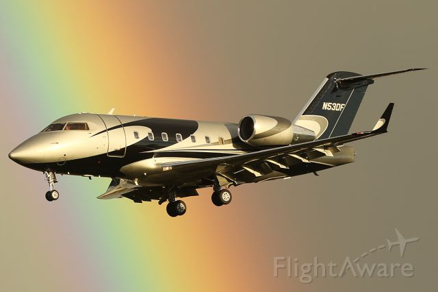 Canadair Challenger (N53DF) - Lands with a rainbow in the background.