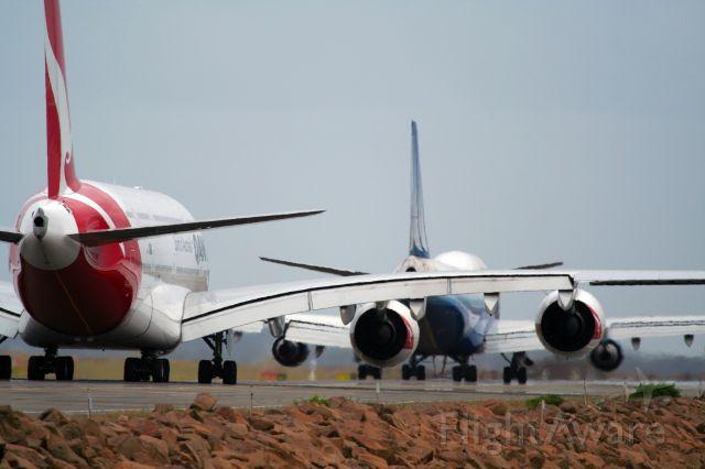 Airbus A380-800 (VH-OQA) - Qantas A380 following a United 747 to runway 34L