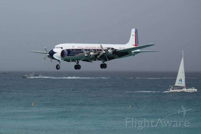Douglas DC-7 (N836D) - N836D landing at St Maarten (TNCM)