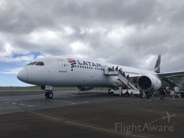 — — - Deplaning onto the tarmac at Mataveri International Airport, Easter Island.