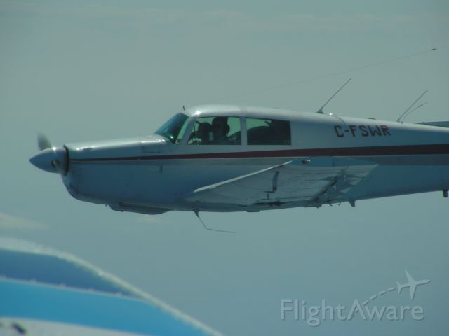 Mooney M-20 (C-FSWR) - Coming home from OSH @ 7000