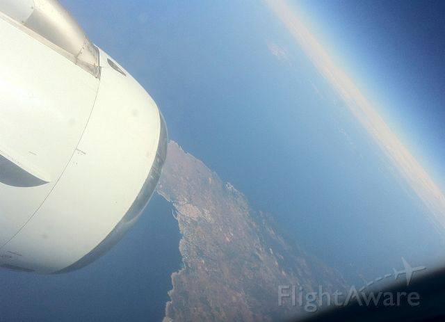 Airbus A320 — - Over the mediterranean. Island between Italy and Majorca