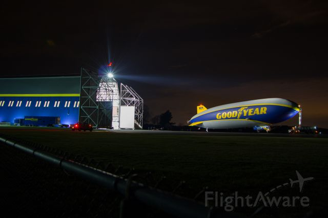 """Unknown/Generic Airship (N2A) - Goodyear Zeppelin N2A """"Wingfoot Two"""" sits waiting for the ground support truck to hook up the towbar before entering the Wingfoot Lake Hangar after a night of crew training flights."""