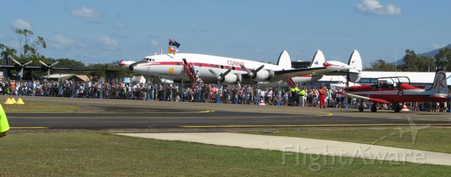 Lockheed EC-121 Constellation (VH-EAG) - Crowd favourite at the Coffs Air Show in 2007 - Connie VH-EAG. Alongside is the Black Cat PBY Catalina, with a Red Arrows display plane sliding past on taxiway.