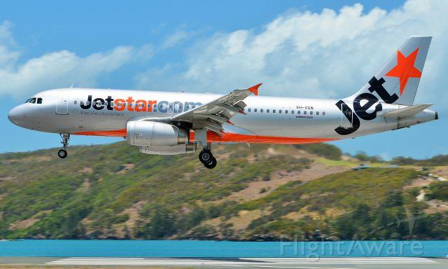 Airbus A320 (VH-VGN) - Piano keys reflecting on the underside of Jetstars A320 landing at Hamilton Island, Qld.