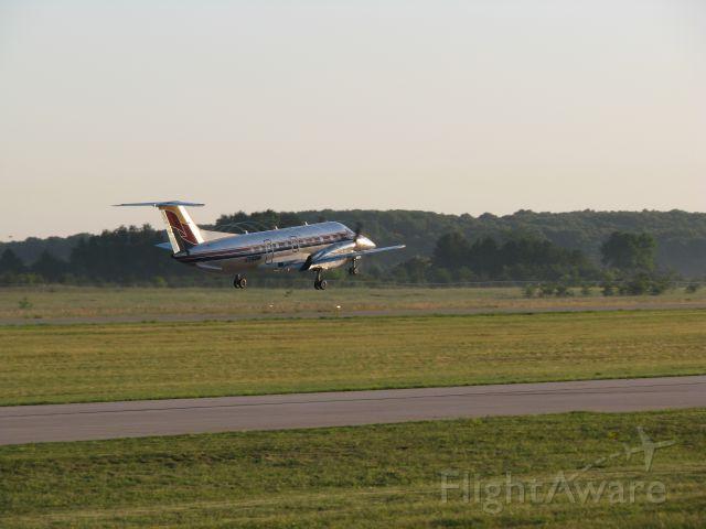 Embraer EMB-120 Brasilia (N597M) - Menards departing runway 4, note the spirals off the props.