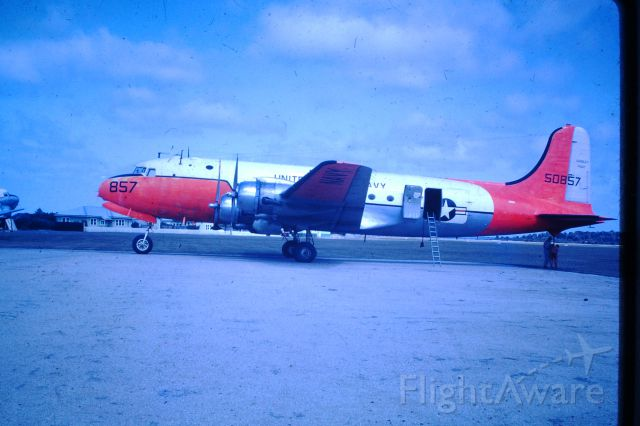 Douglas C-54 Skymaster (50-8857) - US Navy C54 at Flinders Island after flying in a new engine for stranded DC3, circa 1964