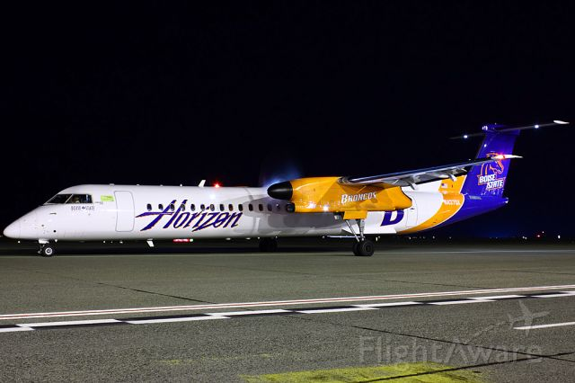 de Havilland Dash 8-400 (N437QX) - A nice 5 second exposure on the Boise State plane heading for BOI as QX268