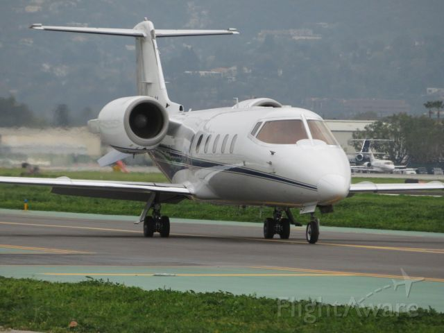Learjet 60 (N975LV) - Taken at the observation area at Van Nuys Airport. This jet was on its way to Aspen, Colorado.