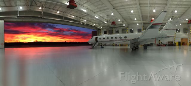 Gulfstream Aerospace Gulfstream V — - Sunset at CLT out of a corporate hangar on the field.