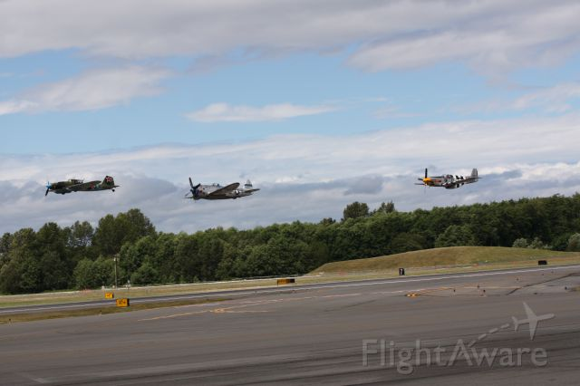 — — - Paine Field, WA. Flying Heritage Collection summer event. IL-2, P=51 & P-47 on a lo-go.