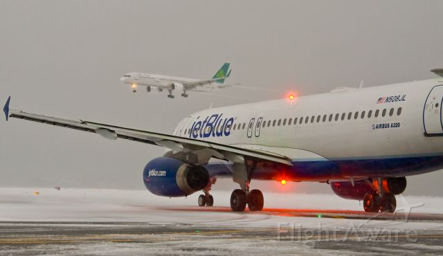 Boeing 757-200 (EI-LBR) - New B757 service to Logan Airport from Shannon landing in heavy snow on 02.13.14