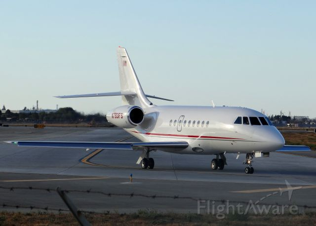 Dassault Falcon 2000 (N783FS) - Taxiing to takeoff Runway 30R. Apologies for the fence in the way