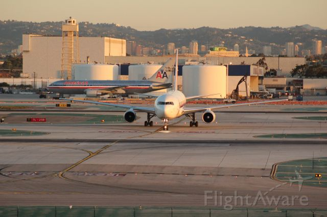 N797AX — - Airborne Express 767 taxiing on an early March morning at LAX as seen through a 75-300mm telephoto lens. Canon EOS Rebel T3i.