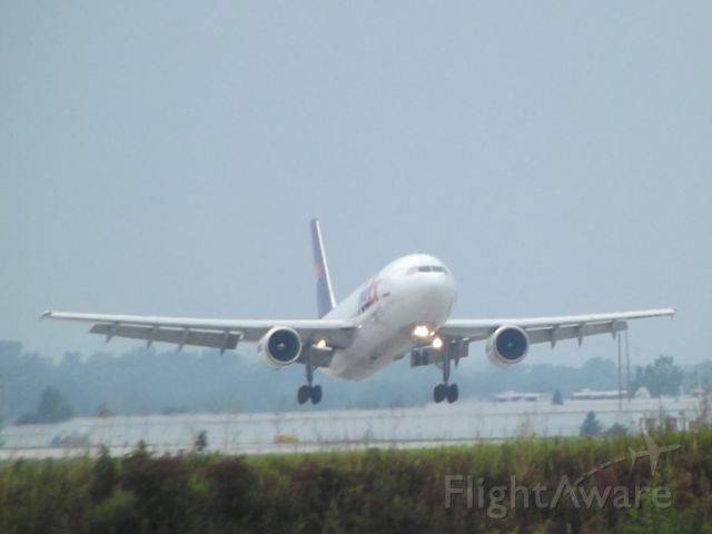 Airbus A300F4-600 — - FedEx flight 713 over the numbers, runway 8R.