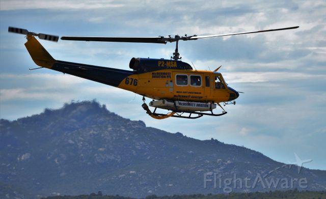 Bell BigLifter (P2-MSA) - Helitac 676 on the way back to Tasmania for the 2017 fire season. Flinders Island, Jan 2017