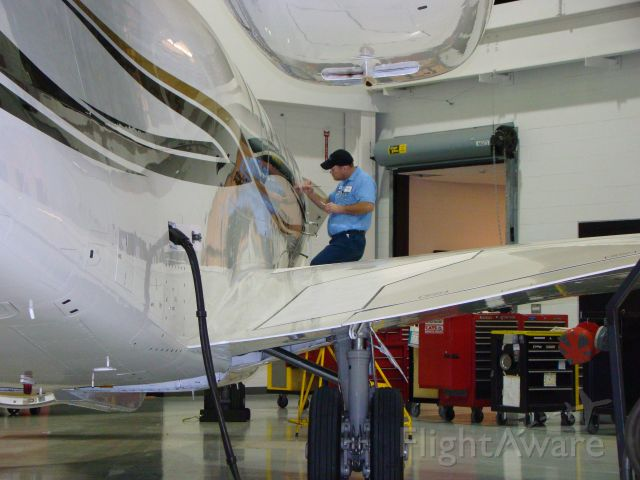 — — - Co- worker, Jason doing paint touch up on Citation X getting ready for the big show NBAA. Cessna Citation Service Center.