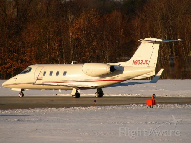 Learjet 55 (N903JC) - Beautiful Lear 55 Departing runway 32 at Nashua in low light on a frigid winter evening