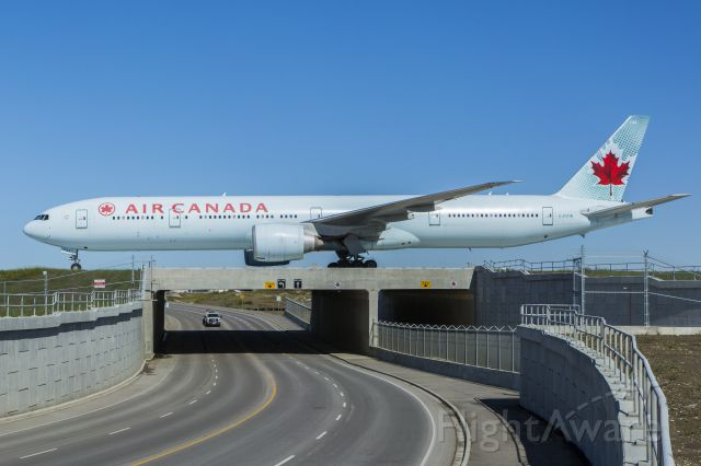 BOEING 777-300ER (C-FITW) - London-Calgary flight arriving over the new taxiway romeo bridge at Calgary