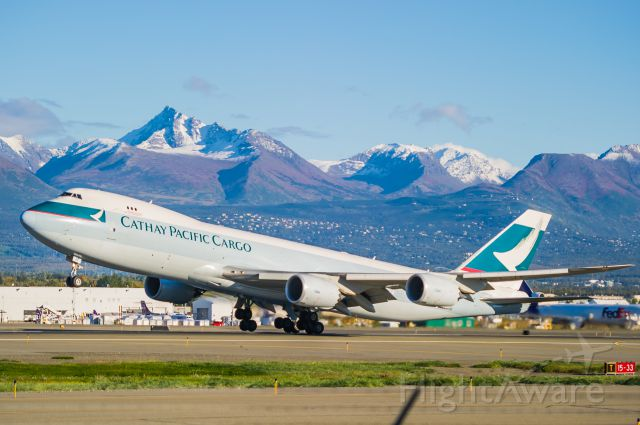 BOEING 747-8 (B-LJF) - Caught at the exact moment of rotation. Cathay Pacific Boeing 748 launches from Anchorage