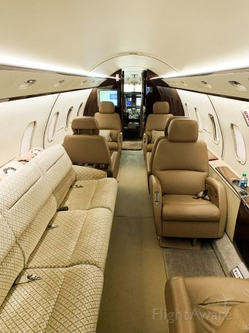 Bombardier Challenger 300 (N517WZ) - Interior of cabin; 3 seat couch and captain chairs.