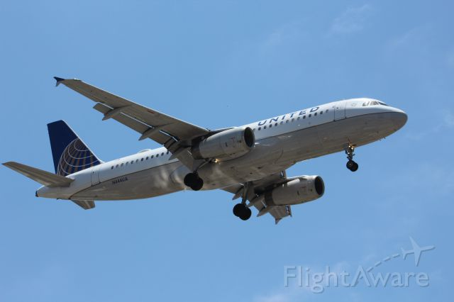 Airbus A320 (N444UA) - Standing at the intersection of Ivy and Albatross in San Diego, overlooking the flight path and runway 27