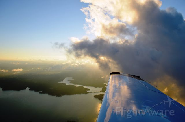 Mooney M-20 (N1068X) - Climb out of KTTA, en route to the AOPA Fly-in at FDK.  4-Oct-2014.