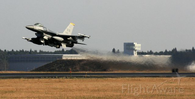 — — - F-16-Falcon taking off from Misawa