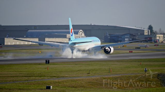 Boeing 777-200 (HL8005) - BOE140 makes tire smoke on landing Rwy 16R to complete a flight test on 2/18/15. ( ln 1278 / cn 37642).