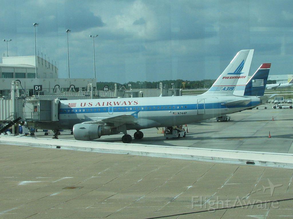 — — - N744P US Airways A319 at KRSW. 11/24/13