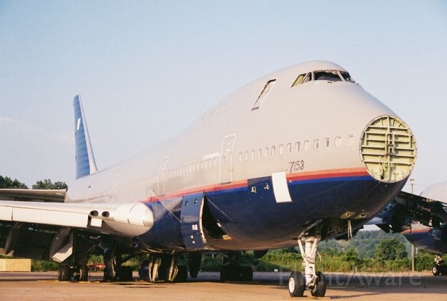 BOEING 747-100 — - A United Airlines 747 headed for the breaker - circa year 2000 at Greenwood-Leflore Airport, GWO.
