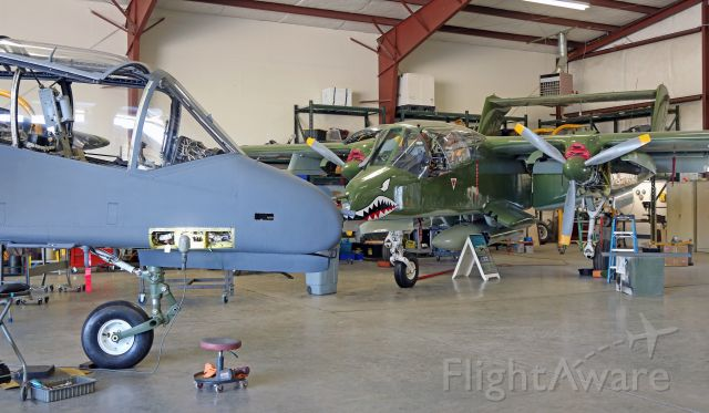 North American Rockwell OV-10 Bronco — - A pair of Broncos are in the barn for a bit of mx.