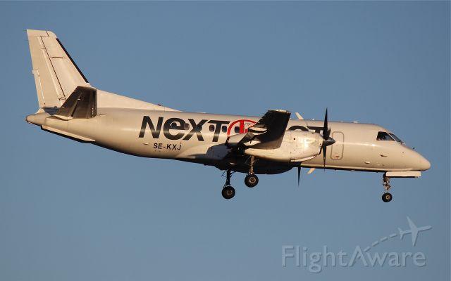 Saab 340 (SE-KXJ) - Landing on rwy 01L.