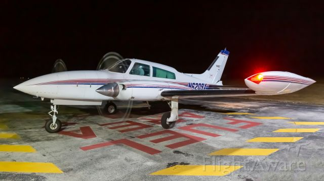 Cessna 310 (N6209X) - On the ramp taking on fuel midway on a six-hour flight.