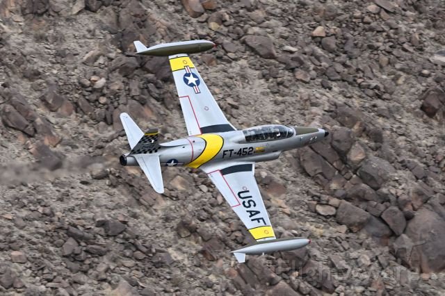 Lockheed T-33 Shooting Star (N133HH) - Flying through Rainbow Canyon, also known as Star War Canyon