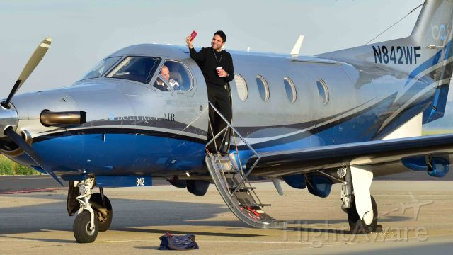 Pilatus PC-12 (N842WF) - Caption contest (Person with the camera is the co-pilot)