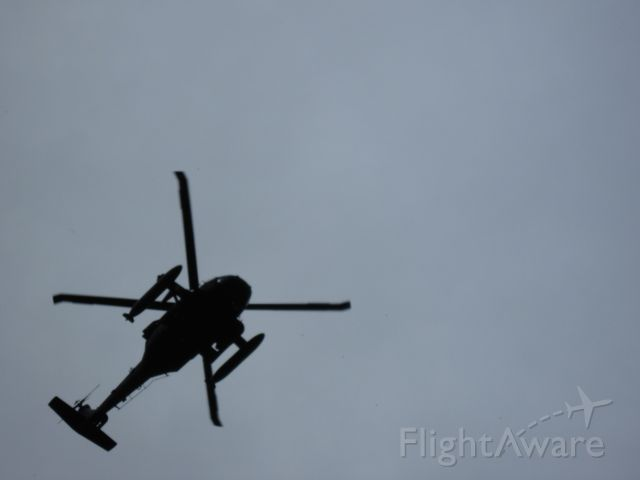 — — - Blackhawk doing touch and goes on a cloudy day directly overhead. Had the camera backed all the way in no zoom.