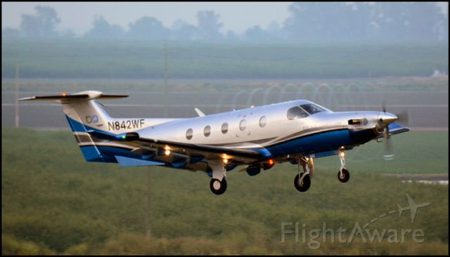 Pilatus PC-12 (N842WF) - Boutique Flight 322 departing Merced Regional Airport.<br />Note the propeller blade