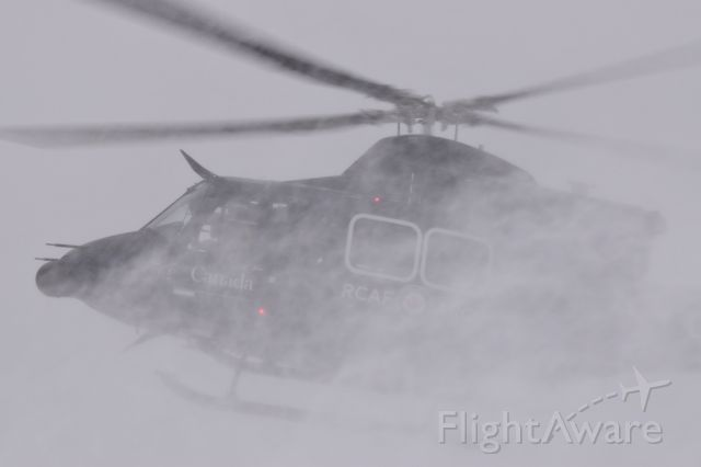 Bell 412 (C-FYZQ) - RCAF Bell 412 creating my very own personal blizzard on departure from Yorkton. There was a miniature snowdrift in my cameras lens hood after it passed. This is the kind of snowblower i want lol.