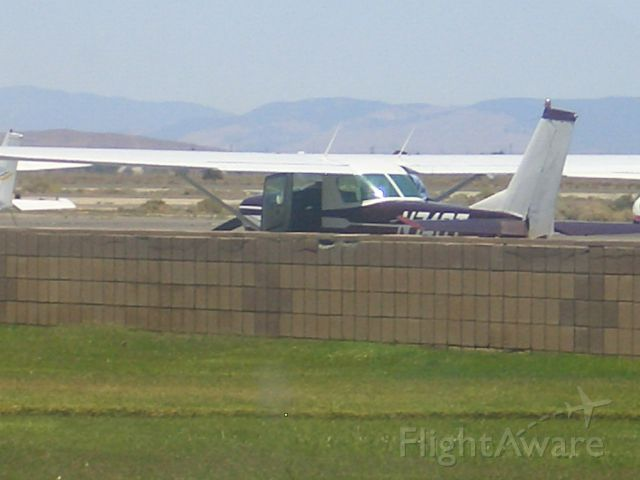 Cessna 152 (N74GT) - The152 is parked and the pre flight inspection is being  preformed.