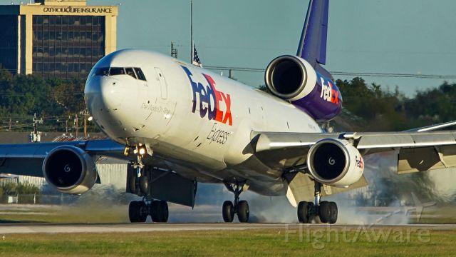 Boeing MD-11 (N608FE) - 31L arrival.
