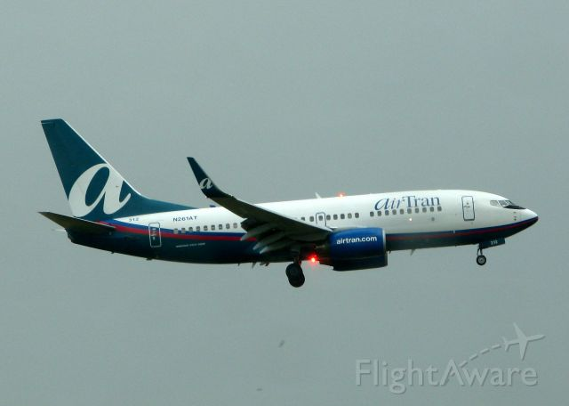 Boeing 737-700 (N261AT) - Landing on 18R at DFW in the pouring rain. I had water on my lens, woops!