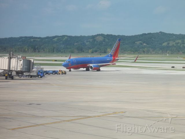 Boeing 737-700 (N266WN) - Southwest 1122 arriving from Chicago Midway at 4:03 P.M.  I had jest been on this flight six months earlier.  Taken August 7, 2011.