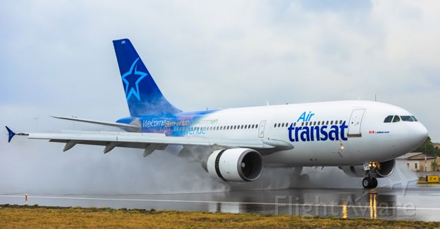Airbus A310 (C-GTSY) - Air Transat Airbus A310 landing at TNCM on a wet runaway 15/04/2017