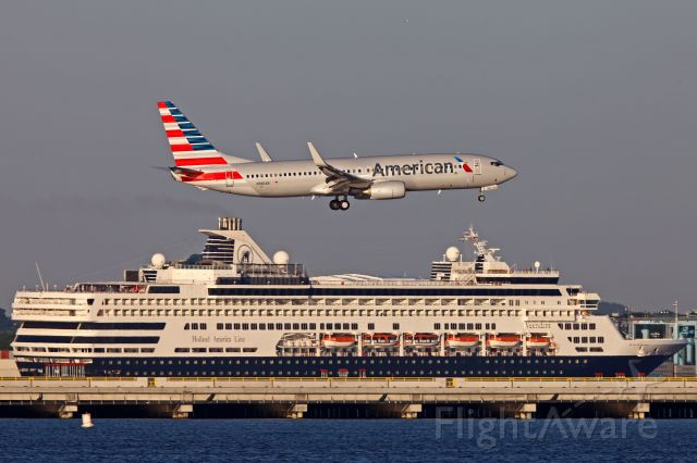 Boeing 737-800 (N981AN) - The cruise ship arriving at the cruise terminal in Boston makes the perfect backdrop for this AA 737 landing on 33L at KBOS.