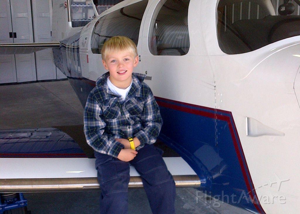 Mooney M-20 Turbo (N411JL) - Hangar time.... Pre-flighting the Mooney