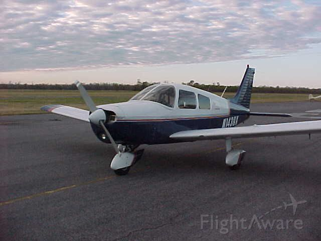 Piper Cherokee (N1439X) - My airplane @ St. Johns parish airport west of New Orleans before its delivery flight home.