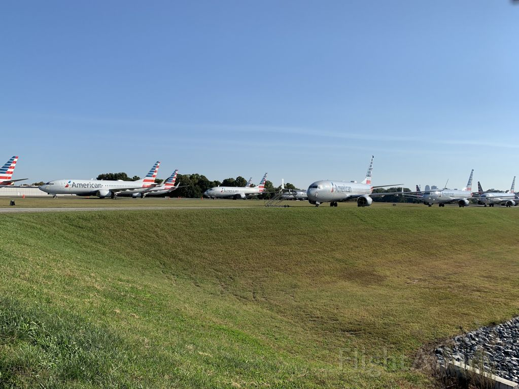 Boeing 737-700 — - Everyone! Hold Short.....Nope, just a bunch more American 37's stored at Smith Reynolds in Winston-Salem.